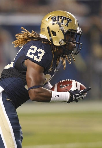 Sep 2, 2013; Pittsburgh, PA, USA; Pittsburgh Panthers defensive back Lafayette Pitts (23) returns the opening kick-off against the Florida State Seminoles during the first quarter at Heinz Field. The Florida State Seminoles won 41-13. Mandatory Credit: Charles LeClaire-USA TODAY Sports