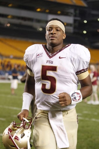Sep 2, 2013; Pittsburgh, PA, USA; Florida State Seminoles quarterback Jameis Winston (5) leaves the field after defeating  the Pittsburgh Panthers at Heinz Field. The Florida State Seminoles won 41-13. Mandatory Credit: Charles LeClaire-USA TODAY Sports