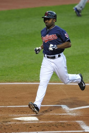 Sep 6, 2013; Cleveland, OH, USA; Cleveland Indians center fielder Michael Bourn (24) scores on a sacrifice fly ball in the first inning against the New York Mets at Progressive Field. Mandatory Credit: David Richard-USA TODAY Sports
