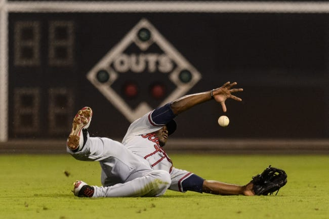 Sep 6, 2013; Philadelphia, PA, USA; Atlanta Braves right fielder Justin Upton (8) fails to make a catch during the fourth inning against the Philadelphia Phillies at Citizens Bank Park. Mandatory Credit: Howard Smith-USA TODAY Sports