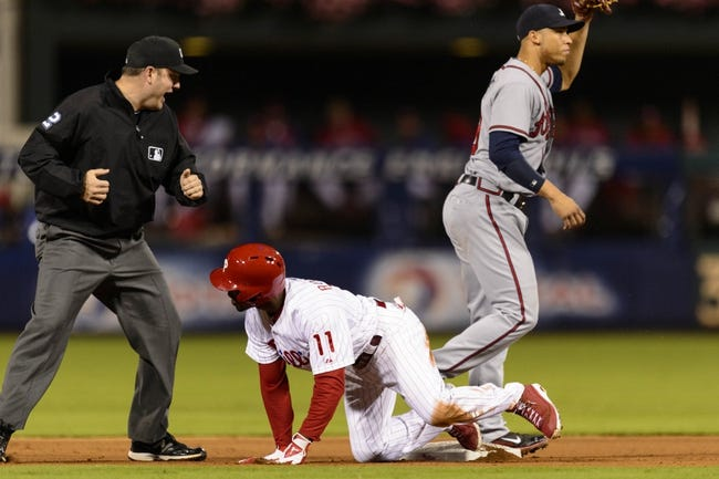 Sep 6, 2013; Philadelphia, PA, USA; Philadelphia Phillies shortstop Jimmy Rollins (11) is called out at second base by second base umpire Dan Bellino as he tried to stretch a single into a double during the fourth inning against the Atlanta Braves at Citizens Bank Park. Mandatory Credit: Howard Smith-USA TODAY Sports