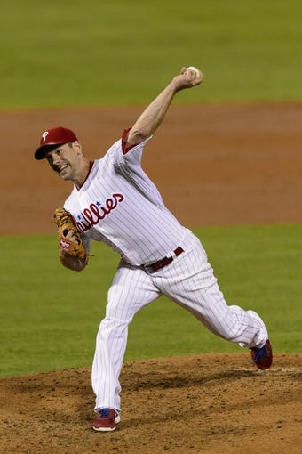 Sep 6, 2013; Philadelphia, PA, USA; Philadelphia Phillies pitcher Cliff Lee (33) delivers to the plate during the third inning against the Atlanta Braves at Citizens Bank Park. Mandatory Credit: Howard Smith-USA TODAY Sports