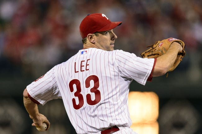 Sep 6, 2013; Philadelphia, PA, USA; Philadelphia Phillies pitcher Cliff Lee (33) delivers to the plate during the fourth inning against the Atlanta Braves at Citizens Bank Park. Mandatory Credit: Howard Smith-USA TODAY Sports