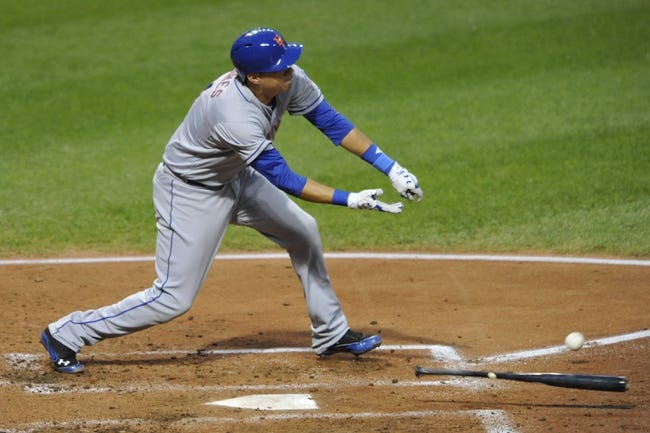 Sep 6, 2013; Cleveland, OH, USA; New York Mets third baseman Wilmer Flores (4) loses his bat on a swing in the third inning against the Cleveland Indians at Progressive Field. Mandatory Credit: David Richard-USA TODAY Sports