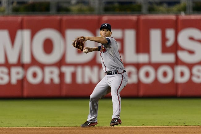 Sep 6, 2013; Philadelphia, PA, USA; Atlanta Braves shortstop Andrelton Simmons (19) throws to first base during the sixth inning against the Philadelphia Phillies at Citizens Bank Park. The Phillies defeated the Braves 2-1. Mandatory Credit: Howard Smith-USA TODAY Sports