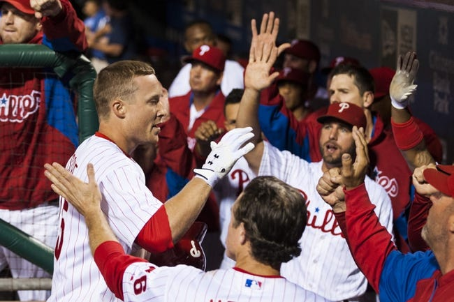 Sep 6, 2013; Philadelphia, PA, USA; Philadelphia Phillies third baseman Cody Asche (25) celebrates hitting a home run with teammates during the seventh inning against the Atlanta Braves at Citizens Bank Park. The Phillies defeated the Braves 2-1. Mandatory Credit: Howard Smith-USA TODAY Sports
