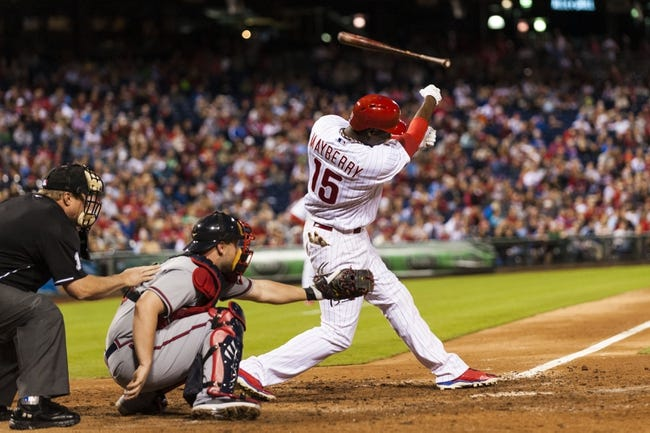 Sep 6, 2013; Philadelphia, PA, USA; Philadelphia Phillies right fielder fielder John Mayberry (15) looses his bat into the stands during an at bat during the seventh inning against the Atlanta Braves at Citizens Bank Park. The Phillies defeated the Braves 2-1. Mandatory Credit: Howard Smith-USA TODAY Sports