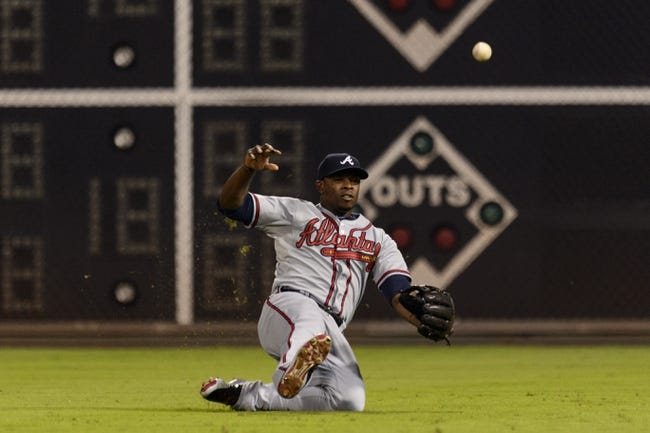 Sep 6, 2013; Philadelphia, PA, USA; Atlanta Braves right fielder Justin Upton (8) fails to make a catch during the fourth inning against the Philadelphia Phillies at Citizens Bank Park. The Phillies defeated the Braves 2-1. Mandatory Credit: Howard Smith-USA TODAY Sports