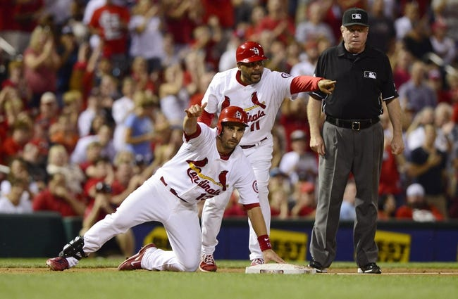 Sep 6, 2013; St. Louis, MO, USA; St. Louis Cardinals second baseman Matt Carpenter (13) celebrates after hitting a triple off of Pittsburgh Pirates starting pitcher A.J. Burnett (not pictured) during the third inning at Busch Stadium. Mandatory Credit: Jeff Curry-USA TODAY Sports