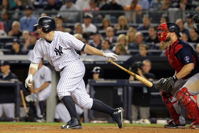 Sep 6, 2013; Bronx, NY, USA; New York Yankees first baseman Mark Reynolds (39) hits an RBI single against the Boston Red Sox during the fifth inning of a game at Yankee Stadium. Mandatory Credit: Brad Penner-USA TODAY Sports