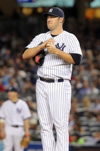 Sep 6, 2013; Bronx, NY, USA; New York Yankees relief pitcher Phil Hughes (65) reacts during the seventh inning of a game against the Boston Red Sox at Yankee Stadium. Mandatory Credit: Brad Penner-USA TODAY Sports