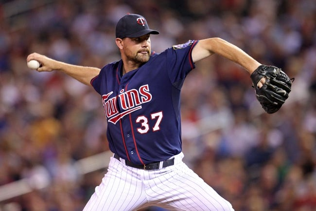 Sep 6, 2013; Minneapolis, MN, USA; Minnesota Twins pitcher Mike Pelfrey (37) delivers a pitch during the fifth inning against the Toronto Blue Jays at Target Field. Mandatory Credit: Brace Hemmelgarn-USA TODAY Sports