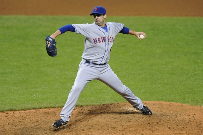 Sep 6, 2013; Cleveland, OH, USA; New York Mets relief pitcher Tim Byrdak (40) delivers in the eighth inning against the Cleveland Indians at Progressive Field. Mandatory Credit: David Richard-USA TODAY Sports