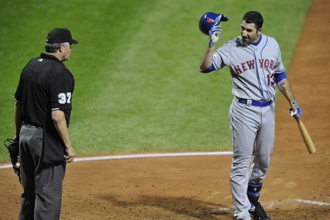 Sep 6, 2013; Cleveland, OH, USA; New York Mets first baseman Josh Satin (13) looks at home plate umpire Gary Darling (37) after being called out on strikes in the eighth inning against the Cleveland Indians at Progressive Field. Mandatory Credit: David Richard-USA TODAY Sports