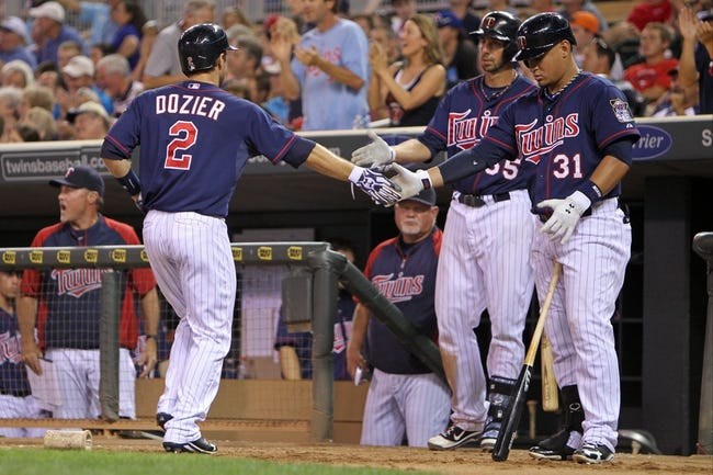Sep 6, 2013; Minneapolis, MN, USA; Minnesota Twins second baseman Brian Dozier (2) is congratulated by outfielder Oswaldo Arcia (31) and first baseman Chris Colabello (55) after scoring a run during the eighth inning against the Toronto Blue Jays at Target Field. The Blue Jays defeated the Twins 6-5. Mandatory Credit: Brace Hemmelgarn-USA TODAY Sports