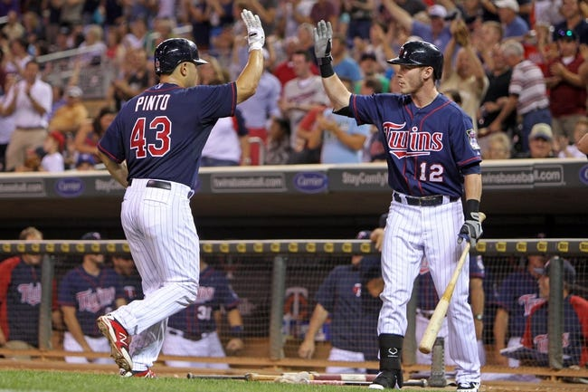 Sep 6, 2013; Minneapolis, MN, USA; Minnesota Twins catcher Josmil Pinto (43) is congratulated by outfielder Chris Herrmann (12) after hitting his first career home run during the ninth inning against the Toronto Blue Jays at Target Field. The Blue Jays defeated the Twins 6-5. Mandatory Credit: Brace Hemmelgarn-USA TODAY Sports