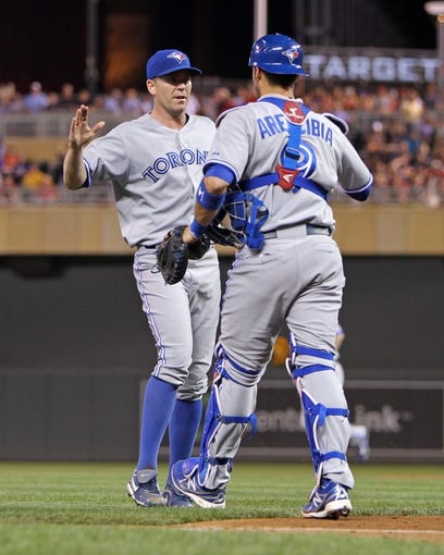 Sep 6, 2013; Minneapolis, MN, USA; Toronto Blue Jays pitcher Casey Janssen (44) celebrates with catcher J.P. Arencibia (9) following the game against the Minnesota Twins at Target Field. The Blue Jays defeated the Twins 6-5. Mandatory Credit: Brace Hemmelgarn-USA TODAY Sports