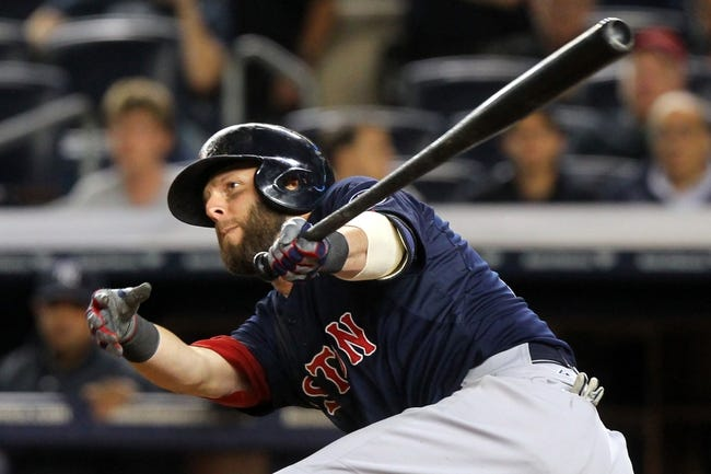 Sep 6, 2013; Bronx, NY, USA; Boston Red Sox second baseman Dustin Pedroia (15) hits a double against the New York Yankees during the ninth inning of a game at Yankee Stadium. Mandatory Credit: Brad Penner-USA TODAY Sports