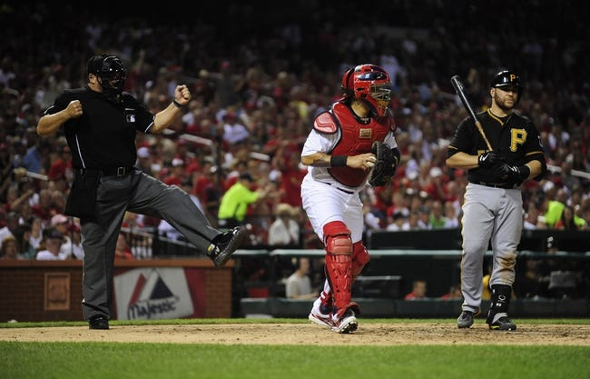 Sep 6, 2013; St. Louis, MO, USA; Pittsburgh Pirates catcher Russell Martin (55) is called out by umpire Tony Randazzo (11) as St. Louis Cardinals catcher Yadier Molina (4) walks off the field during the fifth inning at Busch Stadium. Mandatory Credit: Jeff Curry-USA TODAY Sports