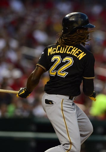Sep 6, 2013; St. Louis, MO, USA; Pittsburgh Pirates center fielder Andrew McCutchen (22) hits a single off of St. Louis Cardinals starting pitcher Joe Kelly (not pictured) during the first inning at Busch Stadium. Mandatory Credit: Jeff Curry-USA TODAY Sports
