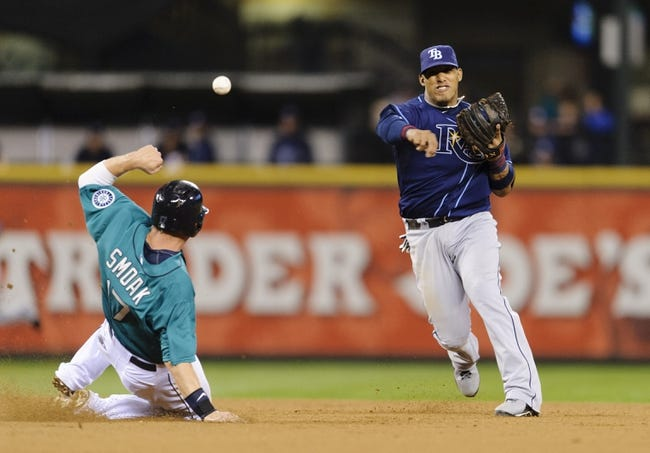 Sep 6, 2013; Seattle, WA, USA; Seattle Mariners first baseman Justin Smoak (17) slides into Tampa Bay Rays shortstop Yunel Escobar (11) at 2nd base to break up the double play during the 4th inning at Safeco Field. Mandatory Credit: Steven Bisig-USA TODAY Sports