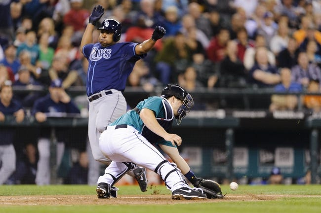 Sep 6, 2013; Seattle, WA, USA; Tampa Bay Rays designated hitter Delmon Young (15) beats the throw to Seattle Mariners catcher Mike Zunino (3) at home plate to score a run during the 6th inning at Safeco Field. Mandatory Credit: Steven Bisig-USA TODAY Sports