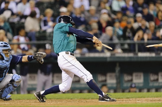 Sep 6, 2013; Seattle, WA, USA; Seattle Mariners shortstop Brad Miller (5) hits a broken bat groundout to the Tampa Bay Rays during the 7th inning at Safeco Field. Mandatory Credit: Steven Bisig-USA TODAY Sports