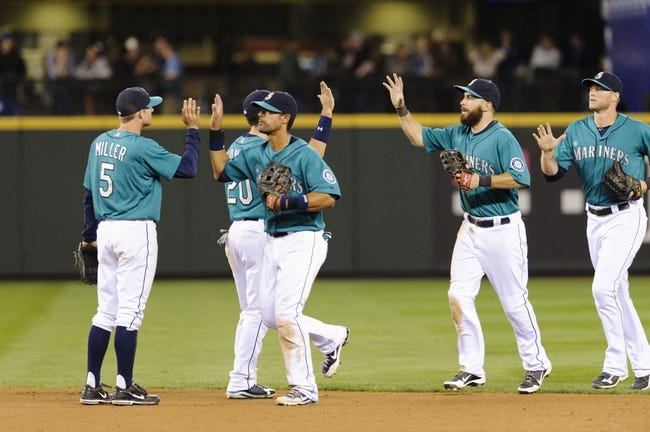 Sep 6, 2013; Seattle, WA, USA; The Seattle Mariners celebrate after defeating the Tampa Bay Rays at Safeco Field. Seattle defeated Tampa Bay 6-4. Mandatory Credit: Steven Bisig-USA TODAY Sports
