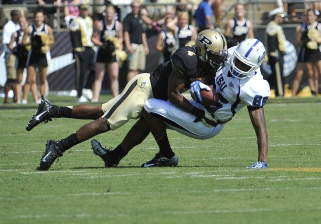 Sep 7, 2013; West Lafayette, IN, USA; Indiana State Sycamores tight end Braxton Shirley (88) is brought down by Purdue Boilermakers safety Taylor Richards (4) at Ross Ade Stadium. Mandatory Credit: Sandra Dukes-USA TODAY Sports