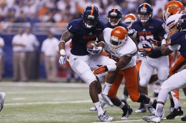 Sep 7, 2013; San Antonio, TX, USA; Texas-San Antonio Roadrunners wide receiver Jones, Kam (1) is tackled by Oklahoma State Cowboys linebacker Catlin, Kris (32) during the first half  at Alamodome. Mandatory Credit: Soobum Im-USA TODAY Sports