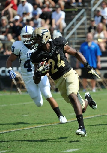 Sep 7, 2013; West Lafayette, IN, USA; Purdue Boilermakers defensive back Frankie Williams (24) turns the corner past Indiana State Sycamores linebacker Isaac Beverstock (43) on a punt return in the first half at Ross Ade Stadium. Mandatory Credit: Sandra Dukes-USA TODAY Sports