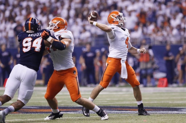Sep 7, 2013; San Antonio, TX, USA; Oklahoma State Cowboys quarterback Walsh, J.W. (4) throws a pass against the Texas-San Antonio Roadrunners during the first half  at Alamodome. Mandatory Credit: Soobum Im-USA TODAY Sports