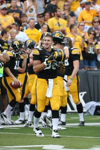 Sep 7, 2013; Iowa City, IA, USA; University of Iowa Hawkeyes tight end C.J. Fiedorowicz (86) looks on during their game against the Missouri State Bears at Kinnick Stadium.  Mandatory Credit: Reese Strickland-USA TODAY Sports