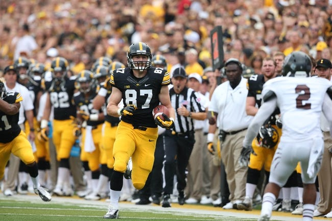 Sep 7, 2013; Iowa City, IA, USA; University of Iowa Hawkeyes tight end Jake Duzey (87) runs for a first down against the Missouri State Bears at Kinnick Stadium.  Mandatory Credit: Reese Strickland-USA TODAY Sports