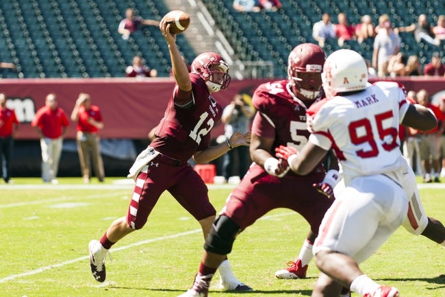 Sep 7, 2013; Philadelphia, PA, USA; Temple Owls quarterback Connor Reilly (12) passes the ball during the second quarter against the Houston Cougars at Lincoln Financial Field. Mandatory Credit: Howard Smith-USA TODAY Sports