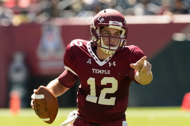 Sep 7, 2013; Philadelphia, PA, USA; Temple Owls quarterback Connor Reilly (12) directs traffic during the second quarter against the Houston Cougars at Lincoln Financial Field. Mandatory Credit: Howard Smith-USA TODAY Sports