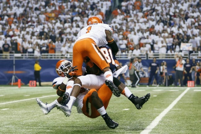 Sep 7, 2013; San Antonio, TX, USA; Oklahoma State Cowboys wide receiver Samples, Ra'Shaad (top) and safety Lowe Daytawion (bottom) collide with Texas-San Antonio Roadrunners wide receiver Bias, Kenny (81) during the first half  at Alamodome. Mandatory Credit: Soobum Im-USA TODAY Sports