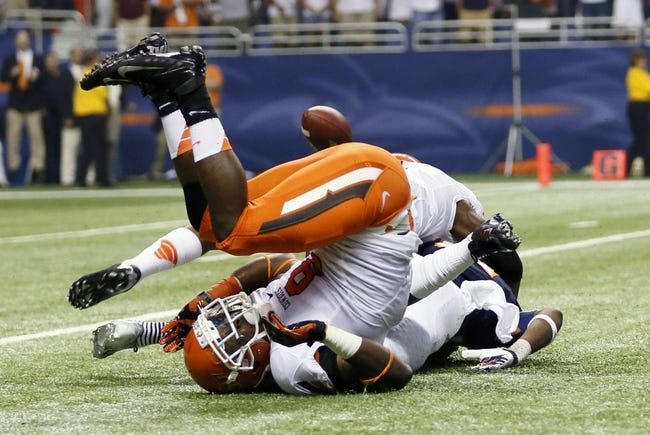 Sep 7, 2013; San Antonio, TX, USA; Oklahoma State Cowboys wide receiver Samples, Ra'Shaad (top) and safety Lowe Daytawion (front) collide with Texas-San Antonio Roadrunners wide receiver Bias, Kenny (bottom) during the first half  at Alamodome. Mandatory Credit: Soobum Im-USA TODAY Sports