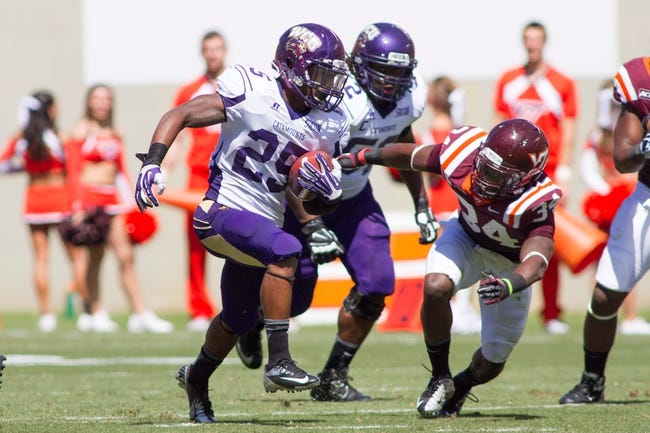 Sep 7, 2013; Blacksburg, VA, USA; Western Carolina Catamounts running back Garry Lewis (25) runs the ball while being chased by Virginia Tech Hokies safety Kyshoen Jarrett (34) during the second quarter at Lane Stadium. Mandatory Credit: Jeremy Brevard-USA TODAY Sports