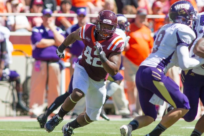Sep 7, 2013; Blacksburg, VA, USA; Virginia Tech Hokies defensive end J.R. Collins (42) pursues the ball during the second quarter against the Western Carolina Catamounts at Lane Stadium. Mandatory Credit: Jeremy Brevard-USA TODAY Sports