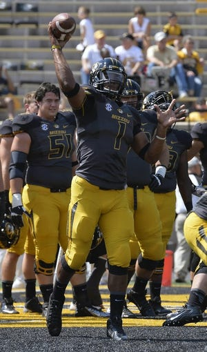 Sep 7, 2013; Columbia, MO, USA;  Missouri Tigers quarterback James Franklin (1) makes a warm up pass prior to the start of the game between the Missouri Tigers and the Toledo Rockets at Faurot Field. Mandatory Credit: Jasen Vinlove-USA TODAY Sports