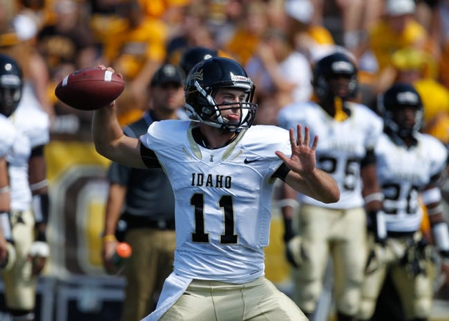 Sep 7, 2013; Laramie, WY, USA; Idaho Vandals quarterback Chad Chalich (11) warms up before the game between the Wyoming Cowboys and the Idaho Vandals at War Memorial Stadium. Mandatory Credit: Troy Babbitt-USA TODAY Sports