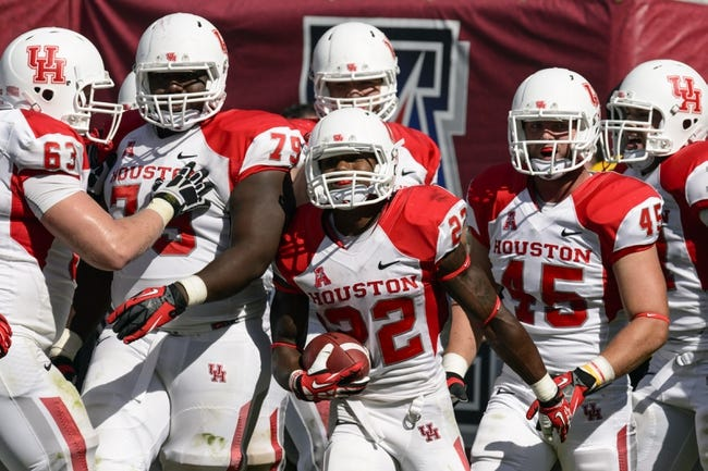 Sep 7, 2013; Philadelphia, PA, USA; Houston Cougars running back Ryan Jackson (22) celebrates scoring a touchdown during the fourth quarter against the Temple Owls at Lincoln Financial Field. Houston defeated temple 22-13. Mandatory Credit: Howard Smith-USA TODAY Sports