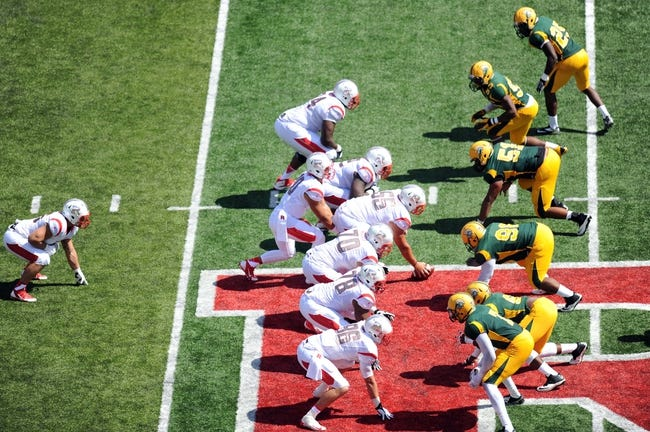Sep 7, 2013; Piscataway, NJ, USA; Rutgers Scarlet Knights and Norfolk State Spartans players line up for a play during the second half at High Point Solutions Stadium. Rutgers won the game 38-0. Mandatory Credit: Joe Camporeale-USA TODAY Sports