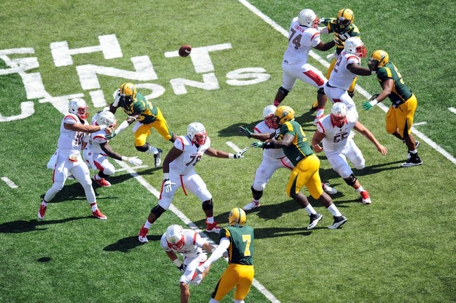Sep 7, 2013; Piscataway, NJ, USA; Rutgers Scarlet Knights quarterback Gary Nova (10) throws a pass against the Norfolk State Spartans during the second half at High Point Solutions Stadium. Rutgers won the game 38-0. Mandatory Credit: Joe Camporeale-USA TODAY Sports