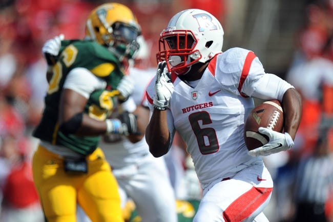 Sep 7, 2013; Piscataway, NJ, USA; Rutgers Scarlet Knights running back Desmon Peoples (6) runs after a catch against the Norfolk State Spartans during the second half at High Point Solutions Stadium. Rutgers won the game 38-0. Mandatory Credit: Joe Camporeale-USA TODAY Sports