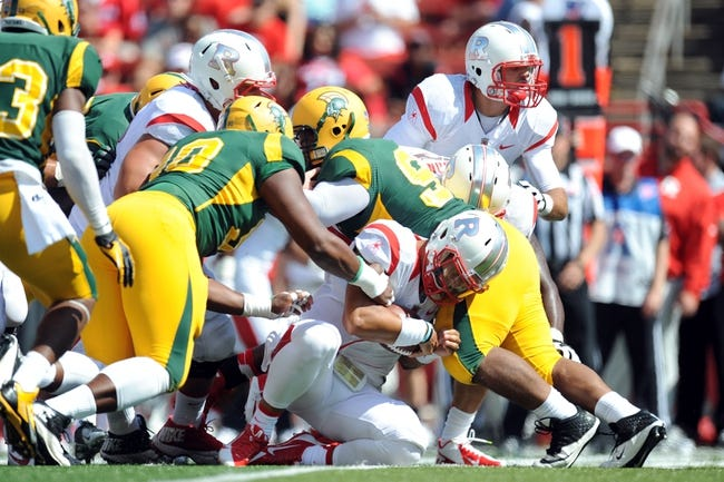 Sep 7, 2013; Piscataway, NJ, USA; Rutgers Scarlet Knights quarterback Gary Nova (10) is tackled during a quarterback sneak against the Norfolk State Spartans during the second half at High Point Solutions Stadium. Rutgers won the game 38-0. Mandatory Credit: Joe Camporeale-USA TODAY Sports