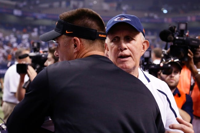 Sep 7, 2013; San Antonio, TX, USA;  Texas-San Antonio Roadrunners head coach Larry Coker (right) meets with Oklahoma State Cowboys head coach Mike Gundy (left) after the game at Alamodome. Oklahoma State Cowboys beat Texas-San Antonio Roadrunners 56-35. Mandatory Credit: Soobum Im-USA TODAY Sports