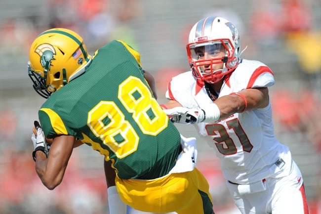 Sep 7, 2013; Piscataway, NJ, USA; Rutgers Scarlet Knights defensive back Anthony Cioffi (31) defends a pass against Norfolk State Spartans wide receiver Isaac White (88) during the second half at High Point Solutions Stadium. Rutgers won the game 38-0. Mandatory Credit: Joe Camporeale-USA TODAY Sports