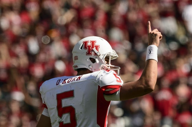 Sep 7, 2013; Philadelphia, PA, USA; Houston Cougars quarterback John O'Korn (5) calls a play during the fourth quarter against the Temple Owls  at Lincoln Financial Field. Houston defeated temple 22-13. Mandatory Credit: Howard Smith-USA TODAY Sports